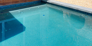 New swimming pool with Skypebble Pebblesheen Shimmering Sea Range interior finish