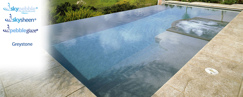 Beautiful inground pool design with Skypebble® finish Greystone