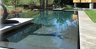 Natural swimming pool with Skypebble interior finish