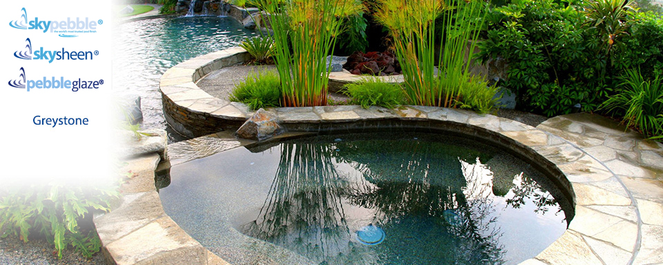 Natural swimming pool with Skypebble® Greystone interior