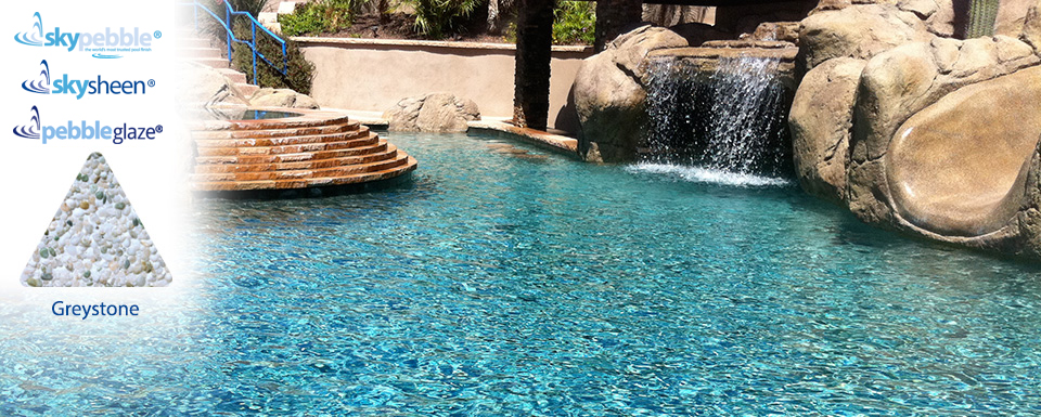 Beautiful natural swimming pool with Skypebble® finish Greystone