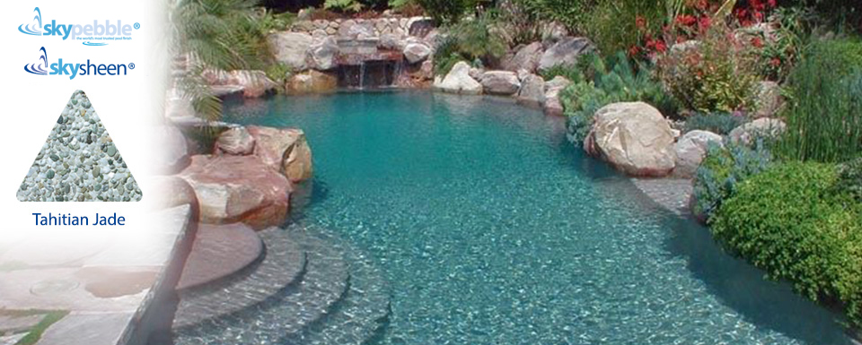 Natural inground pool with Skypebble®'s Tahitian Jade pool interior