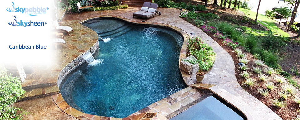 Natural inground pool with Skypebble®'s Caribbean Blue pool interior