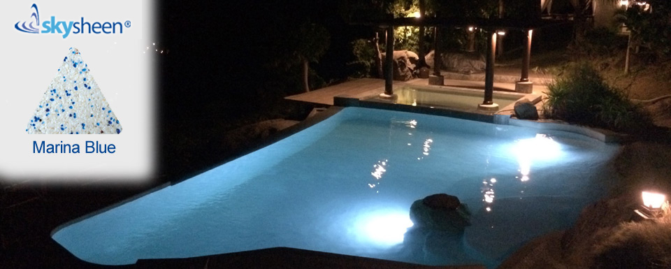 Luxurious pool under lights with Skypebble®'s Marina Blue Skysheen finish