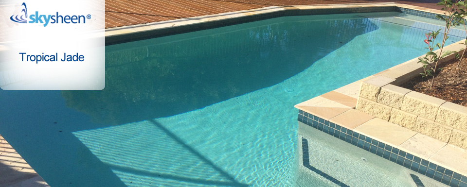 Swimming pool interior with Skypebble®'s Tropical Jade Pebblesheen® finish