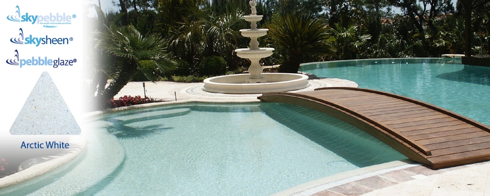 Pool designs with bridge finished with  Skypebble®'s Arctic White interior