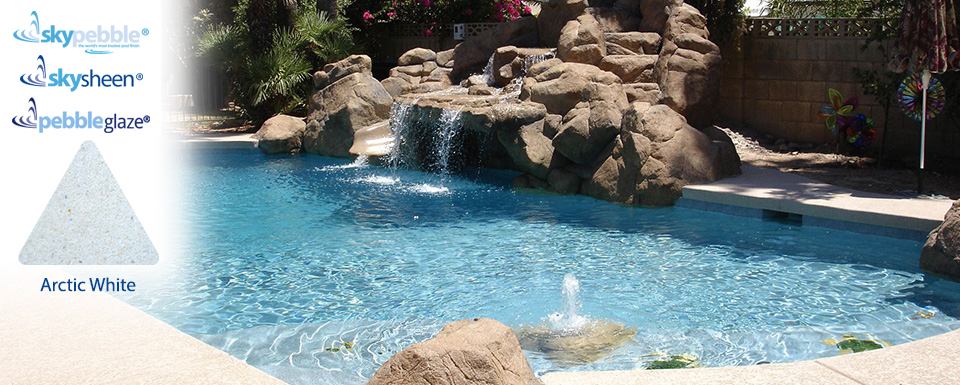 Pool designs natural rock landscape with Skypebble® Arctic White finish