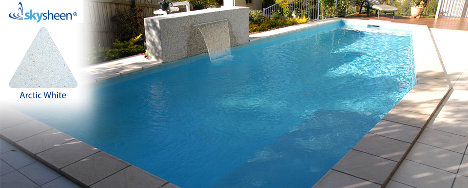 Backyard swimming pools with waterfall finished with Arctic White interior