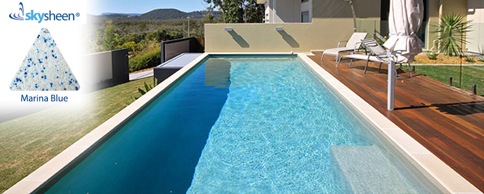 Modern swimming pool designed with Skypebble®'s Marina Blue finish