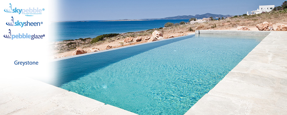 Modern seaside swimming pool with Greystone pebble finish