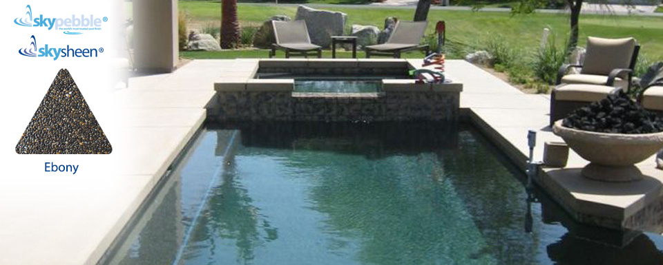 Contemporary backyard swimming pool with Ebony Skypebble®