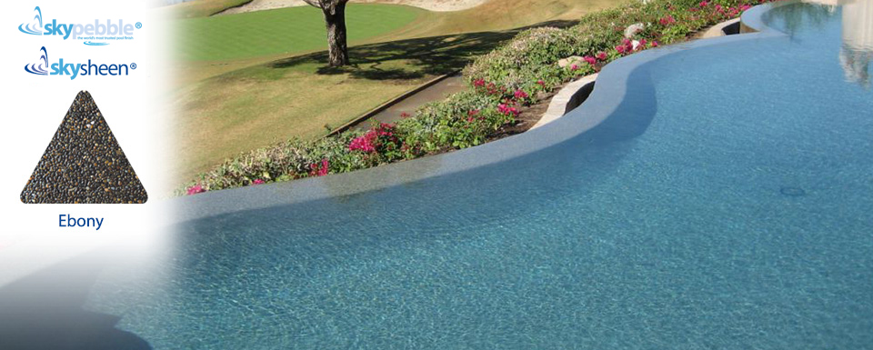 Landscaped swimming pools with Ebony Skypebble® finish