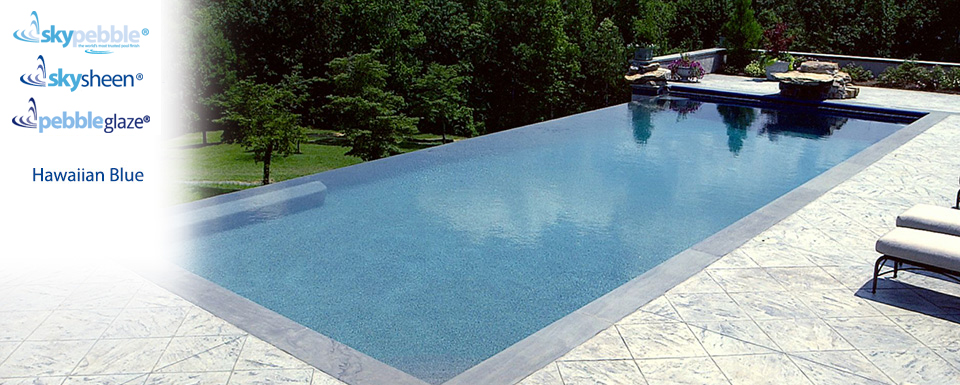 Modern swimming pool designed with Skypebble®'s Hawaiian Blue finish