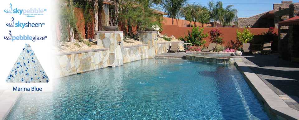 Landscaped swimming pools with Marina Blue Skypebble® finish