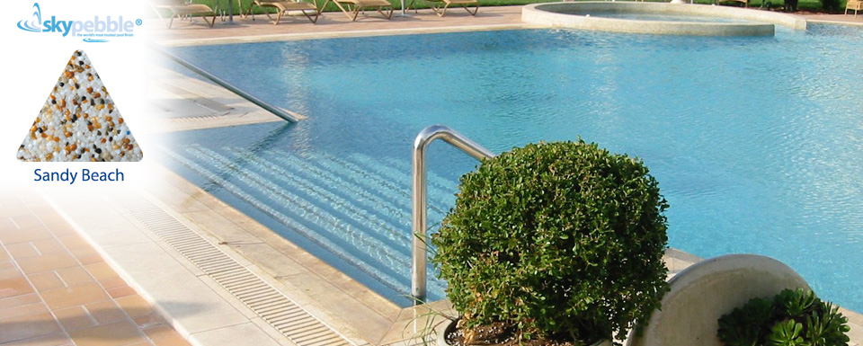 Commercial swimming pool design with Skypebble®'s Sandy Beach interior