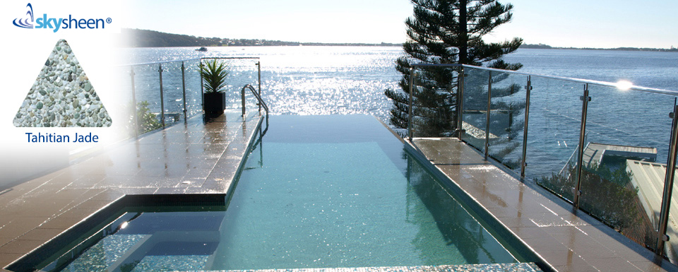 Infinity swimming pools finished with Tahitian Jade Skypebble® interior